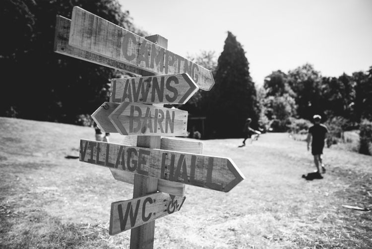 Wooden Picket Fence Direction Sign