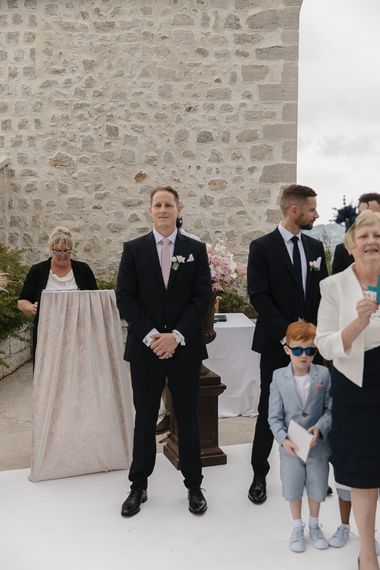 Groom at the Altar | Outdoor Wedding Ceremony | Romantic Pink & White French Riviera Wedding at Chateau Saint Jeannet | Sebastien Boudot Photography | Shoot Me Now Films
