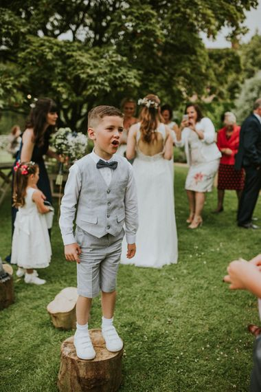 Page Boy in Shorts & Bow Tie | Rustic Tipi Wedding at The Grange, Belluton, Pensford | Images by Felix Russell-Saw & Ryan Winterbotham
