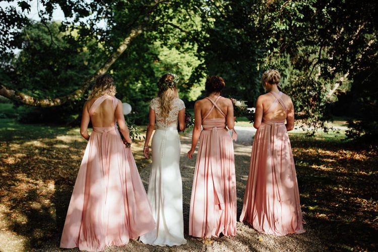 Bride in Bespoke Suzanne Neville Scarlett Bridal Gown | Bridesmaids in Blush Pink Multiway Twobirds Dresses | The Lou's Photography