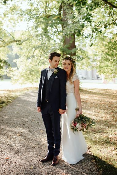 Bride in Bespoke Suzanne Neville Scarlett Bridal Gown | Groom in Herbie Frogg Suit & Liberty Print Mrs Bow Tie | The Lou's Photography