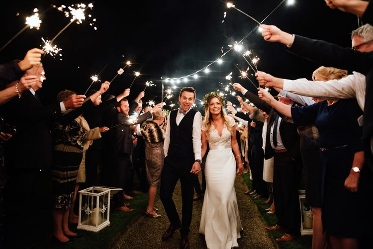 Sparkler Exit | Bride in Bespoke Suzanne Neville Scarlett Bridal Gown | The Lou's Photography