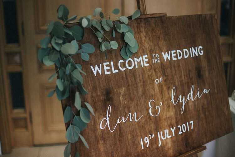 Wooden Welcome Sign with Greenery   Country Wedding at Farmers Barns, Rosedew Farm, Cardiff   Grace Elizabeth Photography and Film