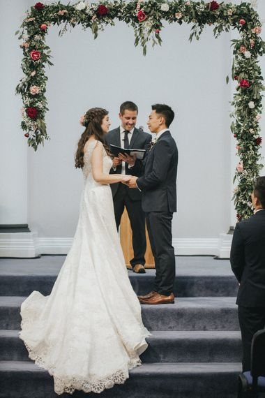 Wedding Ceremony   Floral Garland Altar   Bride in Augusta Jones Sophia Gown   Groom in Slaters Suit   Country Wedding at Farmers Barns, Rosedew Farm, Cardiff   Grace Elizabeth Photography and Film