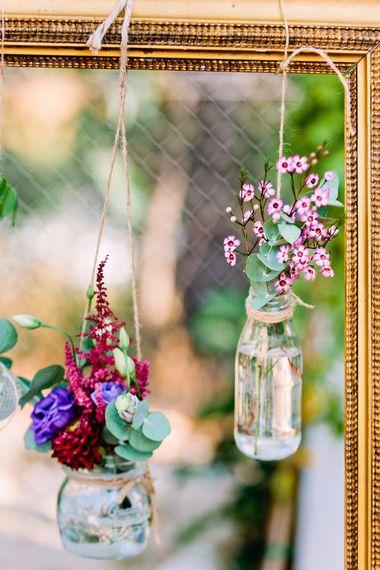 Hanging Bottles with Flowers | Wedding Decor | Jewel Coloured Spanish Wedding Planned & Styled by Rachel Rose Weddings | Anna Gazda Photography