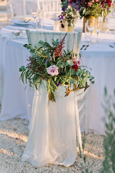 Floral Chair Back Decor | Jewel Coloured Spanish Wedding Planned & Styled by Rachel Rose Weddings | Anna Gazda Photography