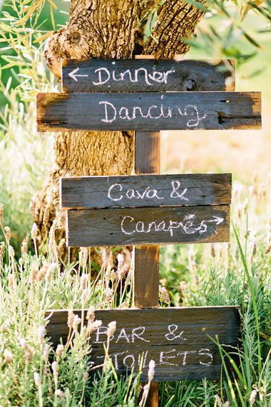 Wooden Direction Sign Post | Jewel Coloured Spanish Wedding Planned & Styled by Rachel Rose Weddings | Anna Gazda Photography