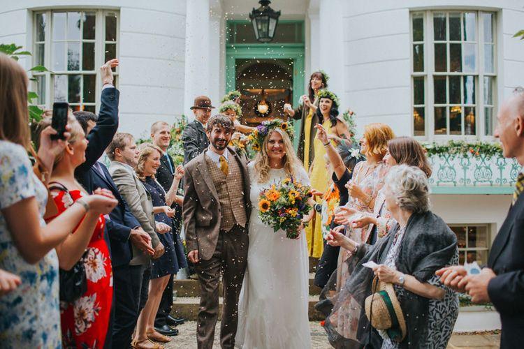 Confetti Exit | Bride in ASOS Wedding Dress | Groom in Tweed Suit | Bright DIY Back Garden Wedding | Lisa Webb Photography | Bright DIY Back Garden Wedding | Lisa Webb Photography