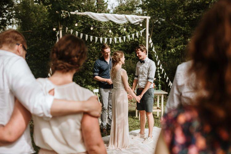 Outdoor Wedding Ceremony With Bunting & Festoon Lights