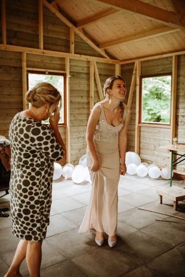 Bride In Bespoke Wedding Dress With Champagne Underlay