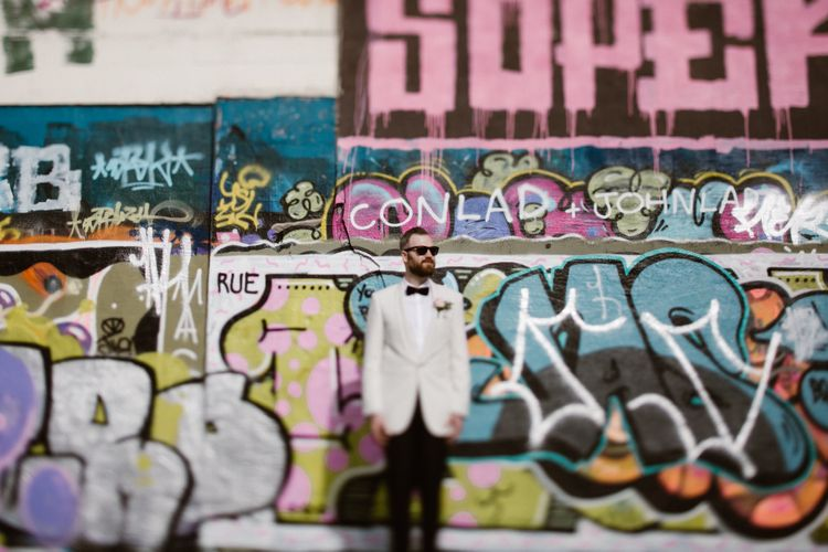 Groom in White Tuxedo Jacket