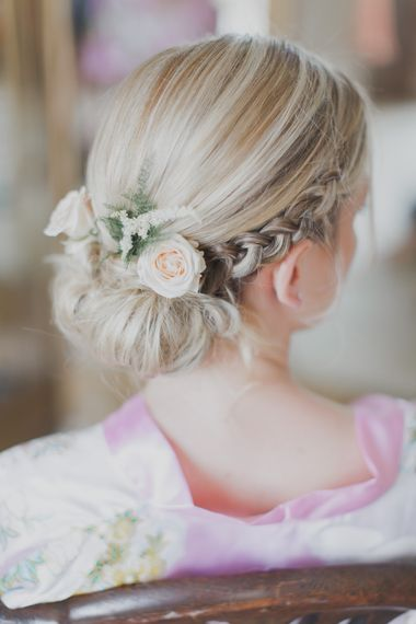 Bridal Up Do With Flowers | Outdoor Peach Wedding at Courteenhall House in Northamptonshire Planned by Your Story Events | Ferri Photography