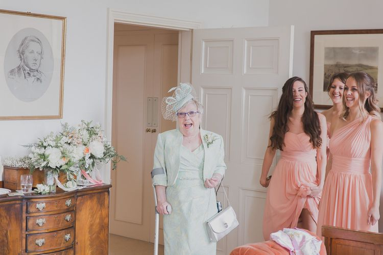 Wedding Morning Bridal Preparations | Outdoor Peach Wedding at Courteenhall House in Northamptonshire Planned by Your Story Events | Ferri Photography