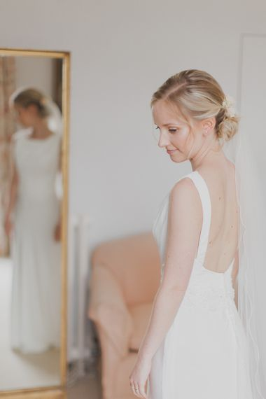 Wedding Morning Bridal Preparations | Justin Alexander Gown | Outdoor Peach Wedding at Courteenhall House in Northamptonshire Planned by Your Story Events | Ferri Photography