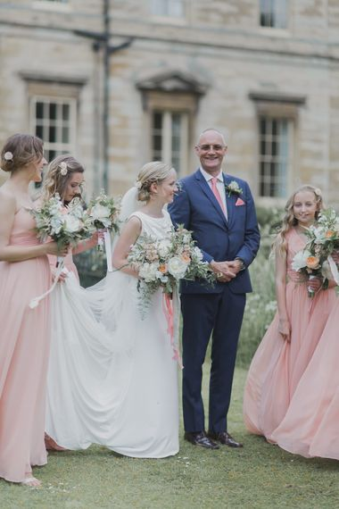 Bridal Party | Bridal Entrance in Justin Alexander Gown | Outdoor Peach Wedding at Courteenhall House in Northamptonshire Planned by Your Story Events | Ferri Photography