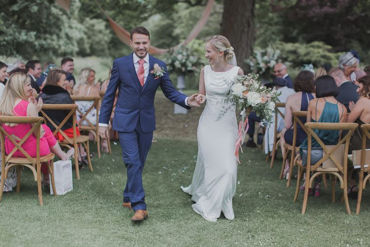 Wedding Ceremony | Bride in Justin Alexander Gown | Groom in Moss Bros Suit | Outdoor Peach Wedding at Courteenhall House in Northamptonshire Planned by Your Story Events | Ferri Photography
