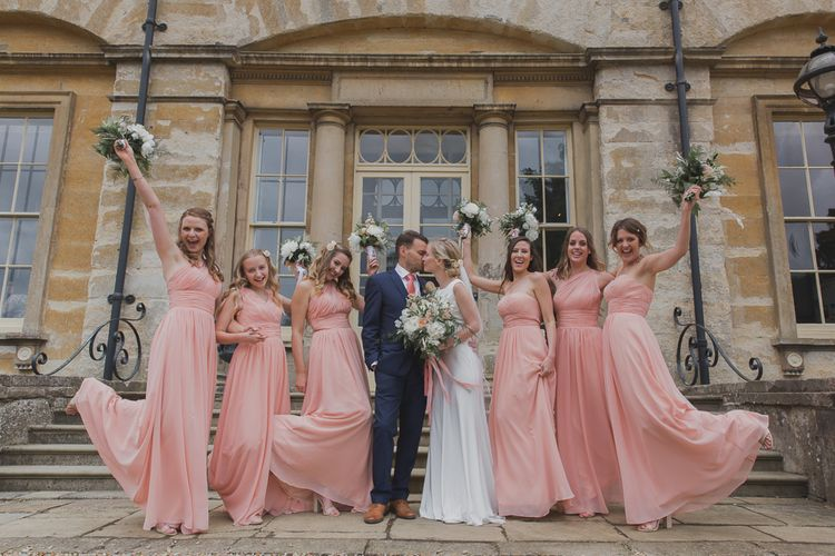 Bridesmaids in Peach Sexyher Dresses | Bride in Justin Alexander Gown | Groom in Moss Bros Suit | Outdoor Peach Wedding at Courteenhall House in Northamptonshire Planned by Your Story Events | Ferri Photography
