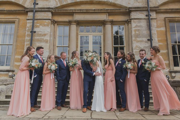 Wedding Party | Bride in Justin Alexander Gown | Groom in Moss Bros Suit | Outdoor Peach Wedding at Courteenhall House in Northamptonshire Planned by Your Story Events | Ferri Photography
