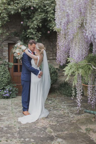 Bride in Justin Alexander Gown | Groom in Moss Bros Suit | Outdoor Peach Wedding at Courteenhall House in Northamptonshire Planned by Your Story Events | Ferri Photography
