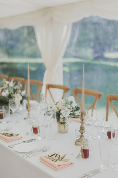 Candle Stick Decor & Votives | Outdoor Peach Wedding at Courteenhall House in Northamptonshire Planned by Your Story Events | Ferri Photography