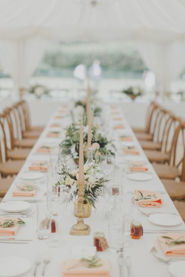 Candle Stick Centrepieces | Outdoor Peach Wedding at Courteenhall House in Northamptonshire Planned by Your Story Events | Ferri Photography