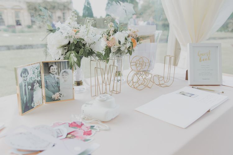 Guest Book Table Decor | Outdoor Peach Wedding at Courteenhall House in Northamptonshire Planned by Your Story Events | Ferri Photography