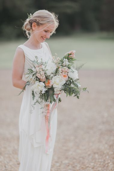 Bride in Justin Alexander Gown | Outdoor Peach Wedding at Courteenhall House in Northamptonshire Planned by Your Story Events | Ferri Photography