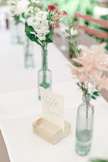 Flower Stems in Bottles | Secret Garden Reception at Castle Cottage Cafe, Oakham | White Stag Wedding Photography