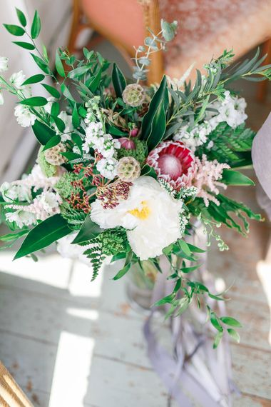 Organic Bridal Bouquet with Protea Flower | Secret Garden Reception at Castle Cottage Cafe, Oakham | White Stag Wedding Photography