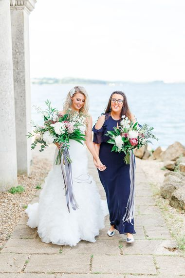 Bride in Pronovias Wedding Dress | Bridesmaid in Navy Dress | Normanton Church on Rutland Water | White Stag Wedding Photography