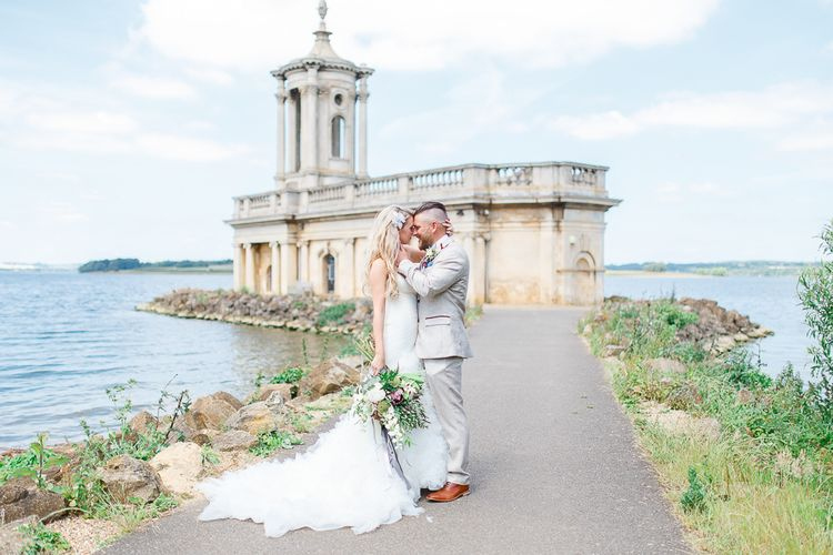 Wedding Ceremony at Normanton Church on Rutland Water | Bride in Pronovias Wedding Dress | Groom in Cream Herringbone Tweed Suit from Marc Darcy | White Stag Wedding Photography