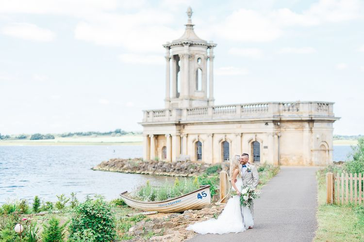 Bride in Pronovias Wedding Dress | Groom in Cream Herringbone Tweed Suit from Marc Darcy | Normanton Church on Rutland Water | White Stag Wedding Photography