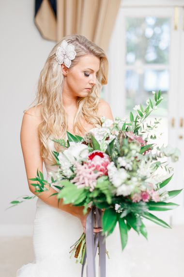 Bride in Pronovias Wedding Dress with Oversized Bouquet | White Stag Wedding Photography