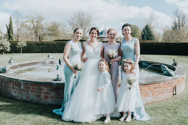 Bride in Sophia Tolli Bridal Gown | Bridesmaids in Pastel Ghost Dresses | Classic Marquee Reception at Chippenham Park | Eliza Claire Photography
