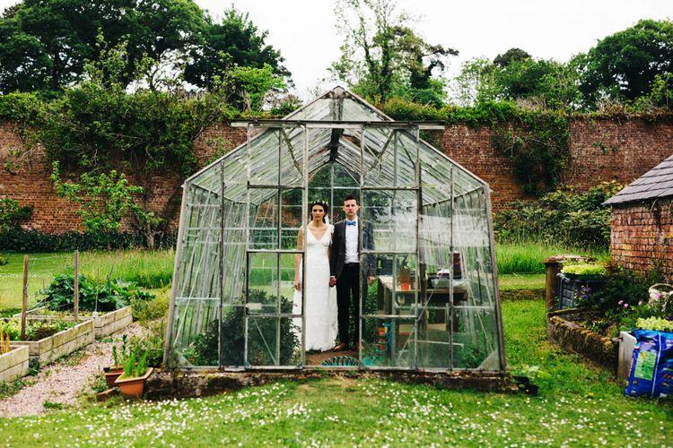 Bride & Groom Green House Portrait