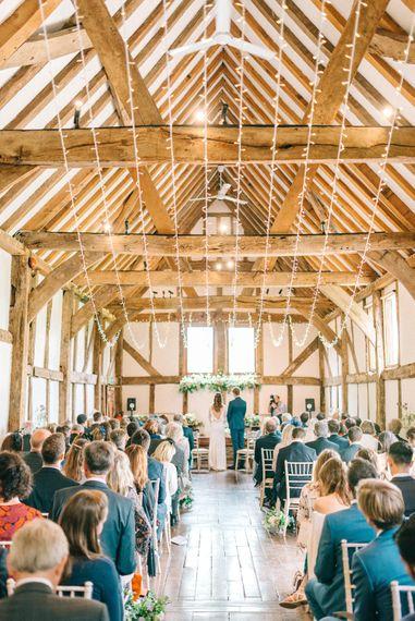 Wedding Ceremony   Bride in Fred & Ginger Bridal Design Gown   Groom in Navy Mullen Mullen Suit   Pastel Spring Wedding at Loseley Park Barn   Sarah-Jane Ethan Photography   Captured Media Weddings Film