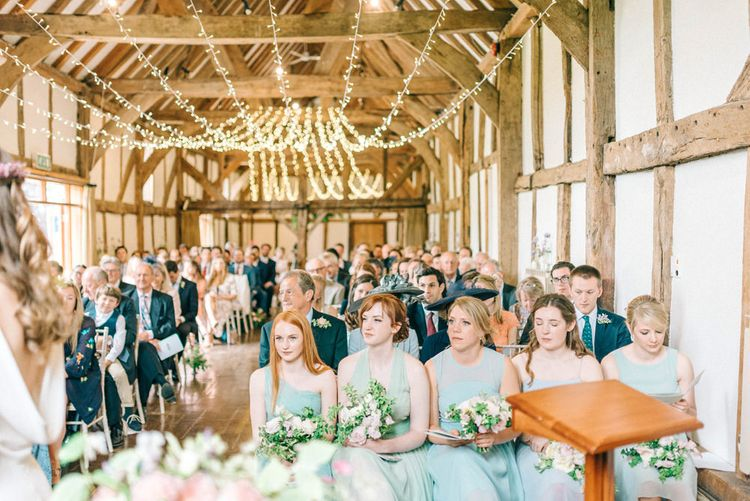 Wedding Ceremony   Bridesmaids in Pale Green & Blue Dresses   Pastel Spring Wedding at Loseley Park Barn   Sarah-Jane Ethan Photography   Captured Media Weddings Film