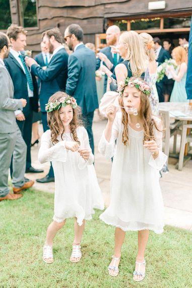 Flower Girls with Flower Crowns   Pastel Spring Wedding at Loseley Park Barn   Sarah-Jane Ethan Photography   Captured Media Weddings Film