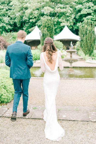 Bride in Fred & Ginger Bridal Design Gown   Groom in Navy Mullen Mullen Suit   Pastel Spring Wedding at Loseley Park Barn   Sarah-Jane Ethan Photography   Captured Media Weddings Film