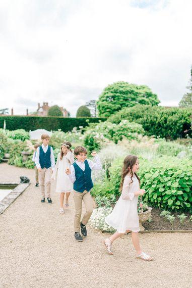 Flower Girls & Page Boys   Pastel Spring Wedding at Loseley Park Barn   Sarah-Jane Ethan Photography   Captured Media Weddings Film
