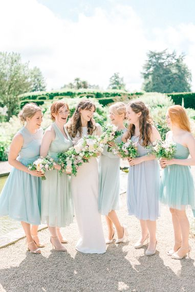 Bride in Fred & Ginger Bridal Design Gown   Bridesmaids in Pale Blue & Green Dresses   Pastel Spring Wedding at Loseley Park Barn   Sarah-Jane Ethan Photography   Captured Media Weddings Film