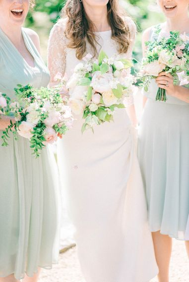 Romantic Peony & Foliage Bouquets   Bride in Fred & Ginger Bridal Design Gown   Bridesmaids in Pale Blue & Green Dresses   Pastel Spring Wedding at Loseley Park Barn   Sarah-Jane Ethan Photography   Captured Media Weddings Film