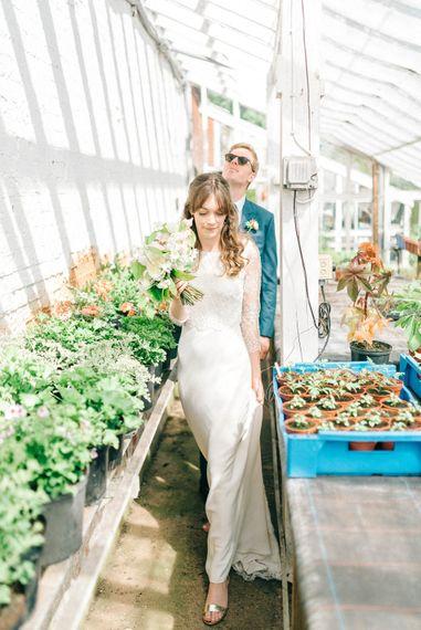 Bride in Fred & Ginger Bridal Design Gown   Groom in Navy Mullen & Mullen Suit   Pastel Spring Wedding at Loseley Park Barn   Sarah-Jane Ethan Photography   Captured Media Weddings Film