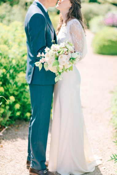 Romantic White Peony & Foliage Bouquet   Bride in Fred & Ginger Bridal Design Gown   Groom in Navy Mullen & Mullen Suit   Pastel Spring Wedding at Loseley Park Barn   Sarah-Jane Ethan Photography   Captured Media Weddings Film