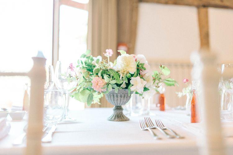 Floral Centrepiece   Pastel Spring Wedding at Loseley Park Barn   Sarah-Jane Ethan Photography   Captured Media Weddings Film