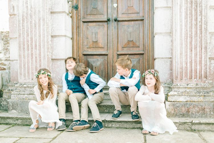 Kids at Weddings   Pastel Spring Wedding at Loseley Park Barn   Sarah-Jane Ethan Photography   Captured Media Weddings Film