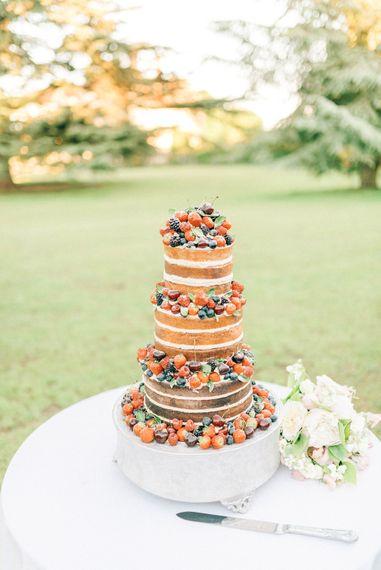 Naked Wedding Cake with Fruit   Pastel Spring Wedding at Loseley Park Barn   Sarah-Jane Ethan Photography   Captured Media Weddings Film