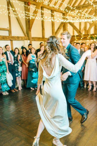 First Dance   Bride in Fred & Ginger Bridal Design Gown   Groom in Navy Mullen & Mullen Suit   Pastel Spring Wedding at Loseley Park Barn   Sarah-Jane Ethan Photography   Captured Media Weddings Film