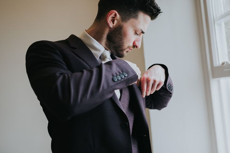 Groom Getting Ready For Winter Wedding