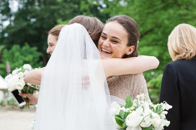 Wedding Guest Hugs | Bride in Ingrida Bridal Gown | Beautiful Classic Wedding at Cornwell Manor | Lucy Davenport Photography